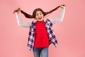 Being Such A Good Girl. Pigtailed Little Girl Pink Background. Happy Girl Hold Long Hair. Small Girl