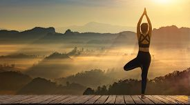 Young Girl Doing Yoga Fitness Exercise Outdoor In Beautiful Mountains And Morning Sunrise. Pose Vita