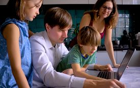 Cute Children Use Laptop For Education, Online Study. Boy And Girl Have Homework At Distance Learnin