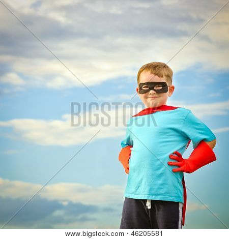 Child pretending to be a superhero