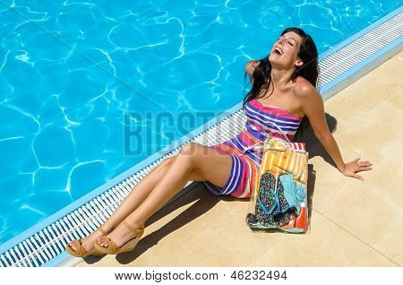 Happy woman on summer in pool