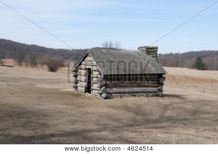 Log Cabin In Field
