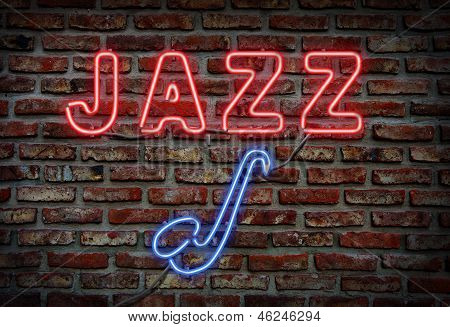 Glowing neon jazz sing on a brick wall. poster