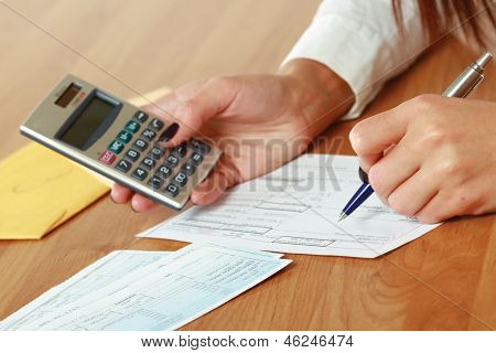 Young woman using a calculator