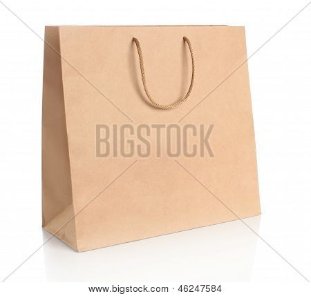 Paper shopping bag with handles over white background.