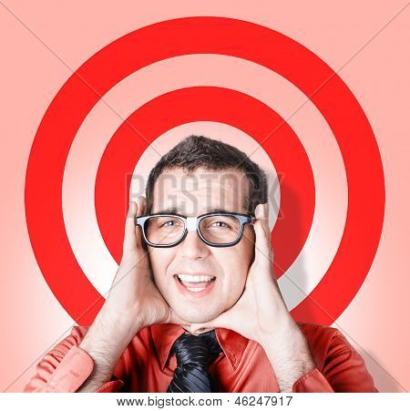 Business Man In Fear On Target Background