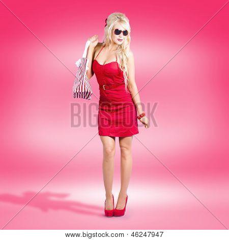 Shop Till You Drop. Female Retail Shopper In Red