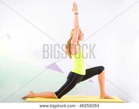Beautiful Pilates Instructor With Yellow Yoga Mat