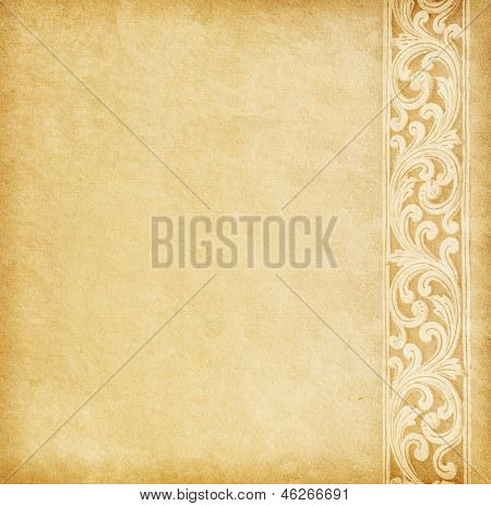 Old worn paper with floral border.