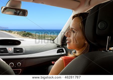 Woman Enjoying The New Car With Husband