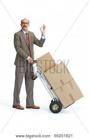 Businessman And Handcart. Ok