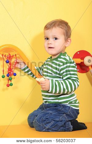 Cute european toddler in kindergarten.