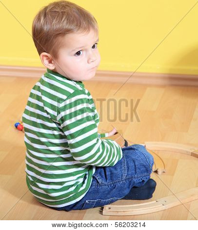 Cute caucasian toddler in kindergarten.
