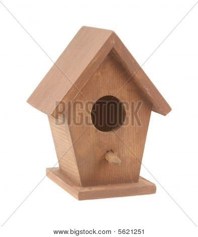 A very small wooden birdhouse against a white background. poster