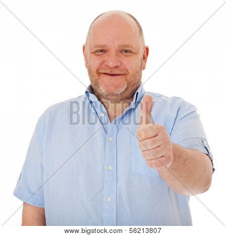 Charismatic middle aged man showing thumbs up. All on white background.