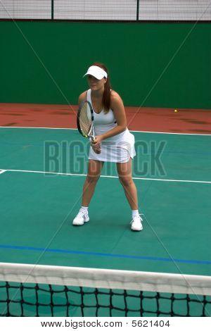Women on tennis court