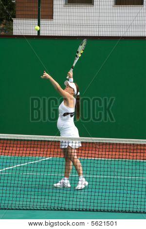 Women play tennis
