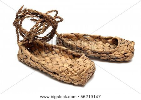old russian bast shoes isolated on white
