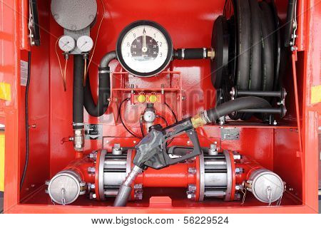 red dashboard of mobile gasoline bowser