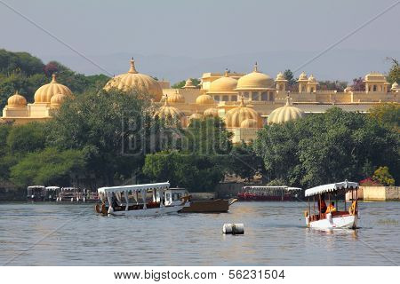 boats and palace on Pichola lake in Udaipur India