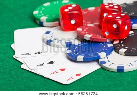 Playing Poker Chips, Dice And Cards On The Green Table