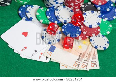 Dice, Four Aces, Colorful Poker Chips And Euro Banknotes On A Green Felt
