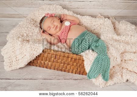 Smiling Newborn Baby Girl In A Mermaid Costume