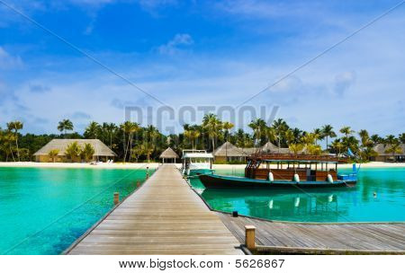 Boat Moored At Tropical Island