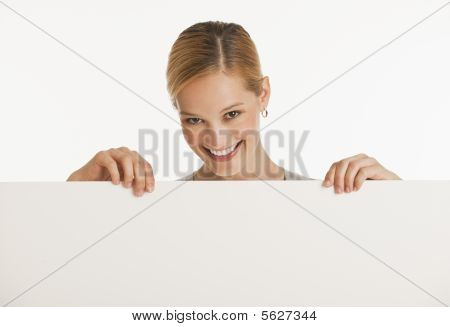 Woman Holding Up Blank Sign For Copy Space
