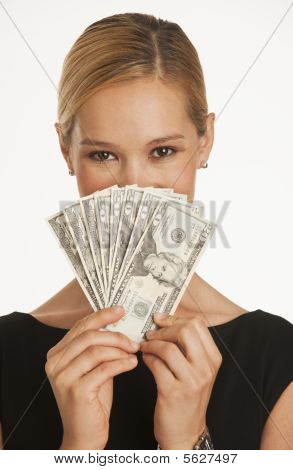 Businesswoman Holding Up Dollars