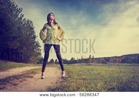 Sexy Brunette Woman Standing on the Road