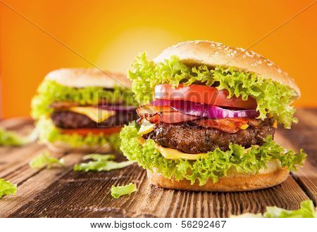 Delicious hamburgers on wood