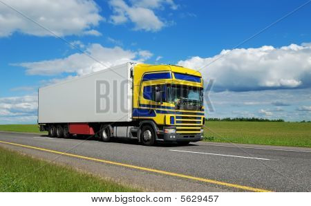 Truck With Blue-yellow Cabin On Highway