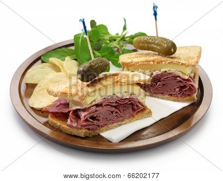 reuben sandwich with pastrami and swiss cheese isolated on white background