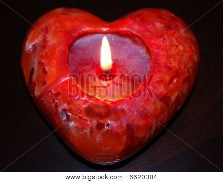 Lit red heart candle, Valentine's day