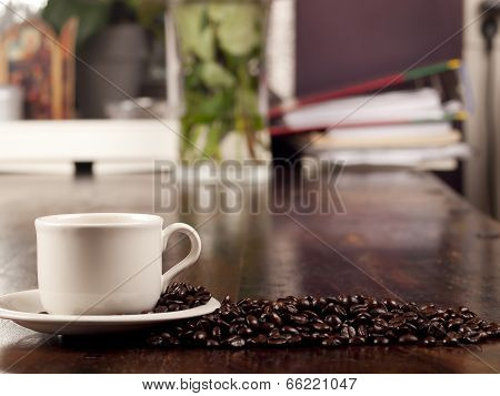Fresh Cup Of Dark Roasted Coffee With Coffeebeans