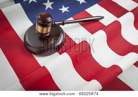 Justice Gavel Resting on an American Flag.