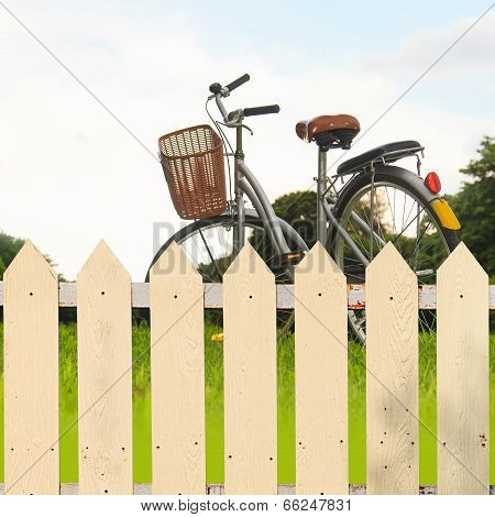 White fences in the garden with bicycles