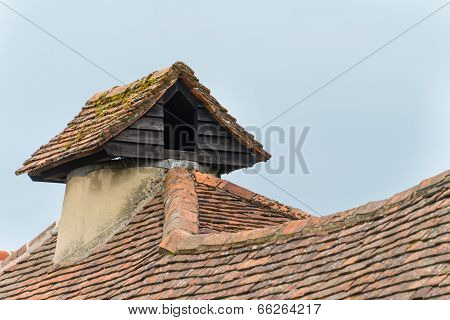 Rustic pigeon loft on roof of traditional English village house poster