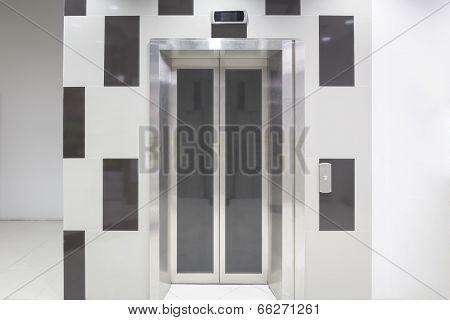 Elevator door (gray color) with white floor. poster