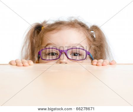 Funny girl in eyeglasses hiding behind a table poster