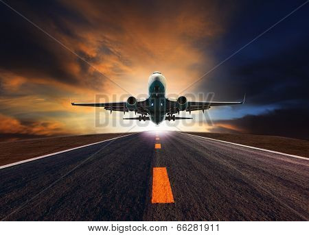 Passenger Jet Plane Flying Over Airport Runway Against Beautiful Dusky Sky Use For Aircraft Transpor