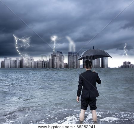 Business Man Holding An Umbrella With Thundershower Background