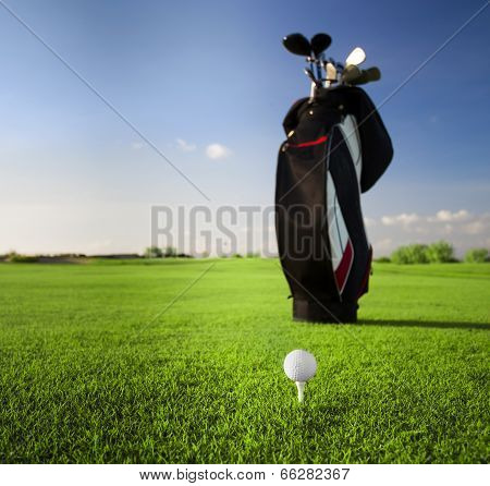 Golf clubs in golfbag and golf balls