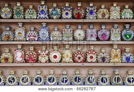 perfume bottles on a shelf