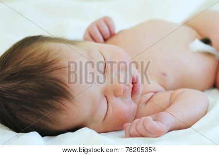 Newborn baby with umbilical cord on his first day in life poster
