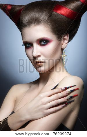 The girl in an image of the demon-tempter with long nails and haircut in the form of horns.