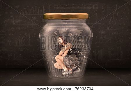 Businesswoman traped in jar with graph chart symbols concept on background