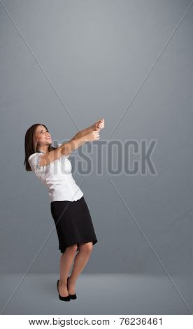 Pretty young lady gesturing with copy space