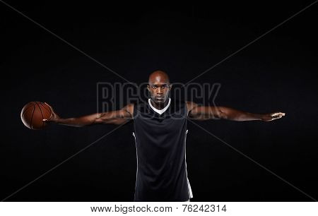 Basketball Player With His Arms Outstretched